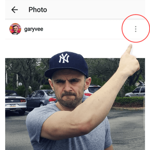 Gary Vaynerchuk pointing to the the three dots above his Instagram post