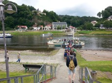 Taking ferry to cross the Elbe river