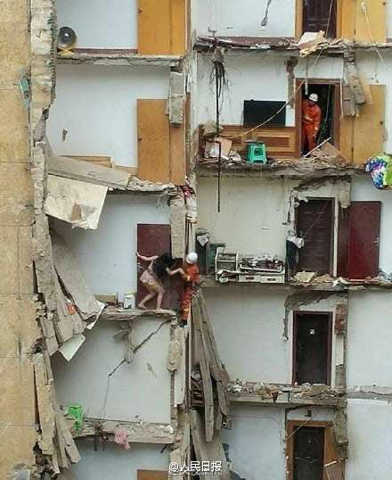 Firefighters rescuing trapped residents in the collapsed building
