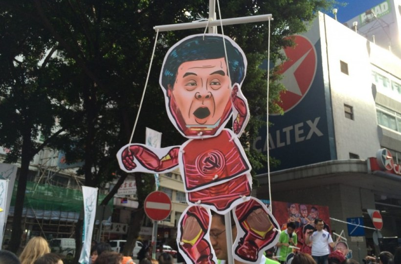 CY Leung puppet at the July 1st march