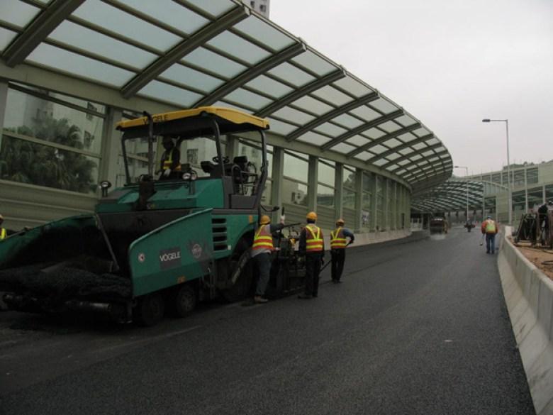 Asphalt is usually used in road paving in Hong Kong.