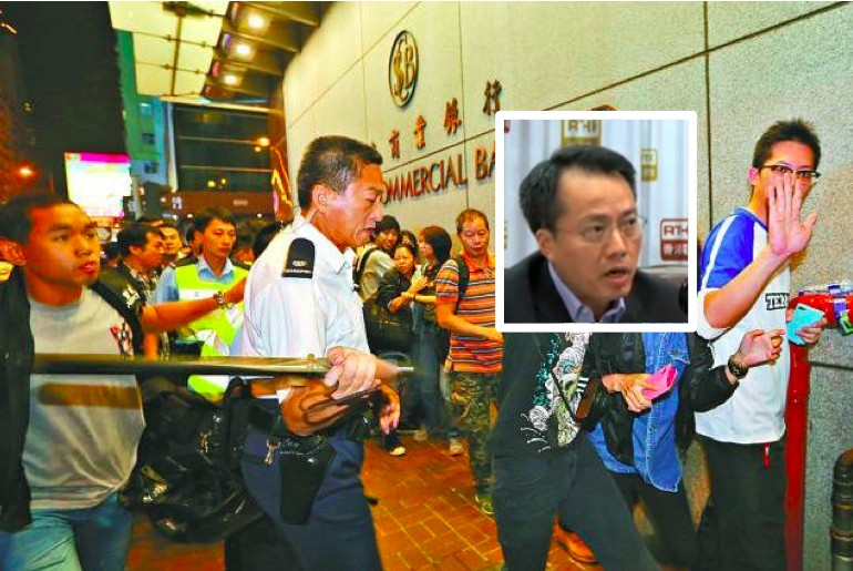 hong kong police occupyhk Chu King-wai was filmed hitting pedestrians with a baton