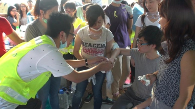 Doctor Ray Leung helping the injured at Occupy protest.
