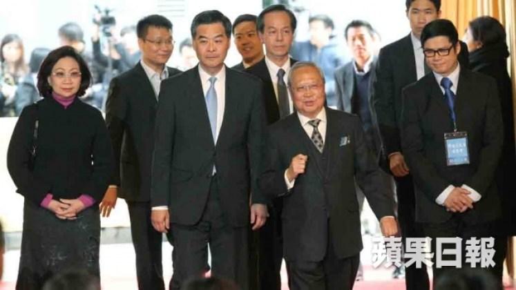Norman Leung Nai-pang and Leung Chun-ying at a funeral.