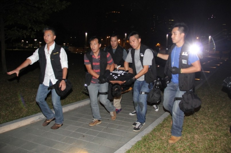 Protester Ken Tsang was moved by seven police and allegedly punched and kicked him.