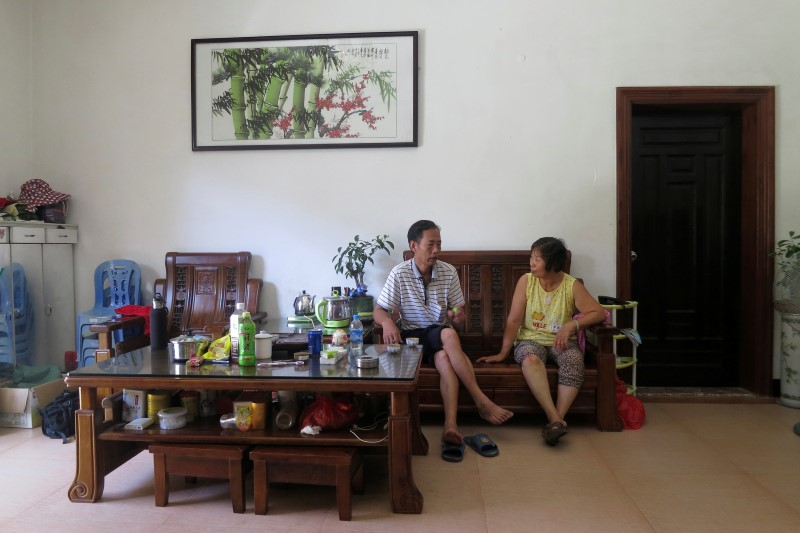 Yang Zhen, wife of arrested village chief Lin Zuluan, talks with another villager in Wukan village in the southern province of Guangdong