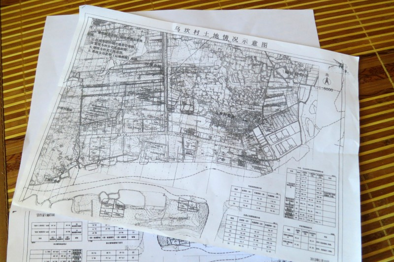 A blueprint of disputed Wukan land is seen in Wukan village in the southern province of Guangdong
