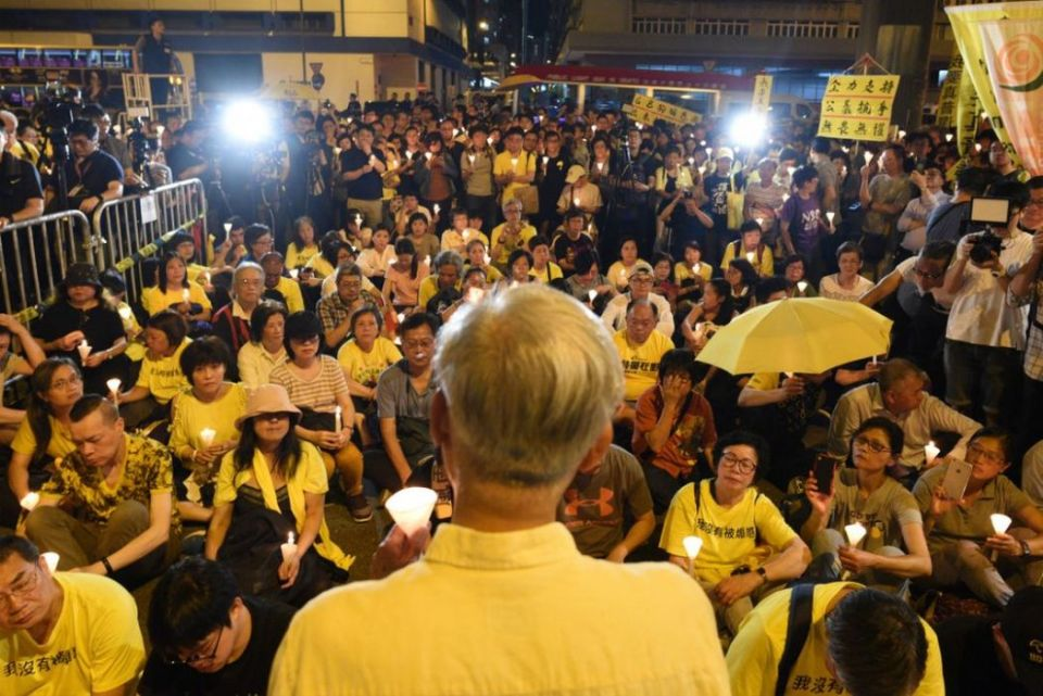 Chu Yiu-ming candlelight vigil umbrella