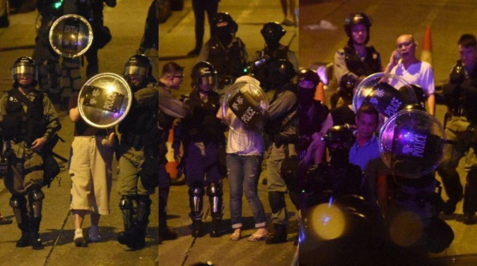 man police shield face