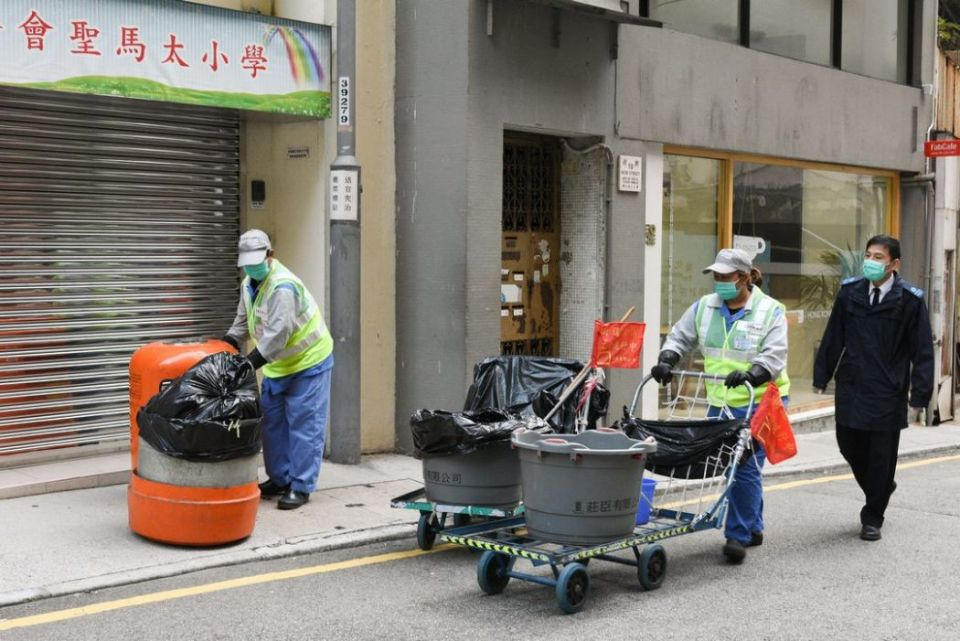 Street cleaners in Hong Kong face mask