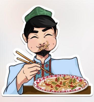 Uyghur man eating a plate of lagman.