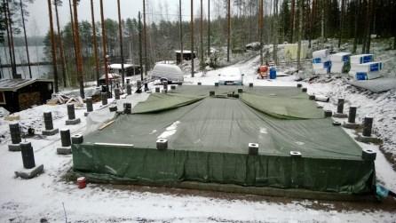 Perustukset peitelty lumen satamisen takia