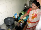 Latika begins to cook lunch
