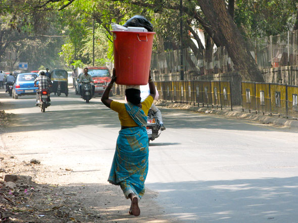 Women traditionally carry their loads on their head. No matter how weighty…