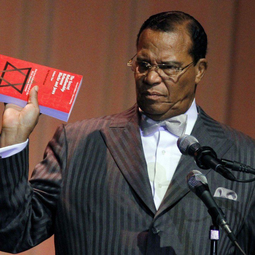 A picture of the Nation of Islam's Louis Farrakhan holding a book with a star of David on it.