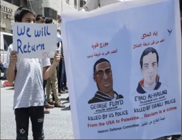 Revolutionary internationalism: A #BlackLivesMatter solidarity action in occupied Palestine drawing connections between the murders of George Floyd and autistic Palestinian youth, Eyad Al-Hallaq
