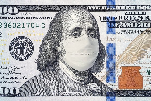 Capitalism during COVID-19: colonizer/founding father Ben Franklin on the 100 dollar bill wearing a mask