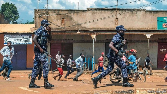 Uganda police break up a protest.