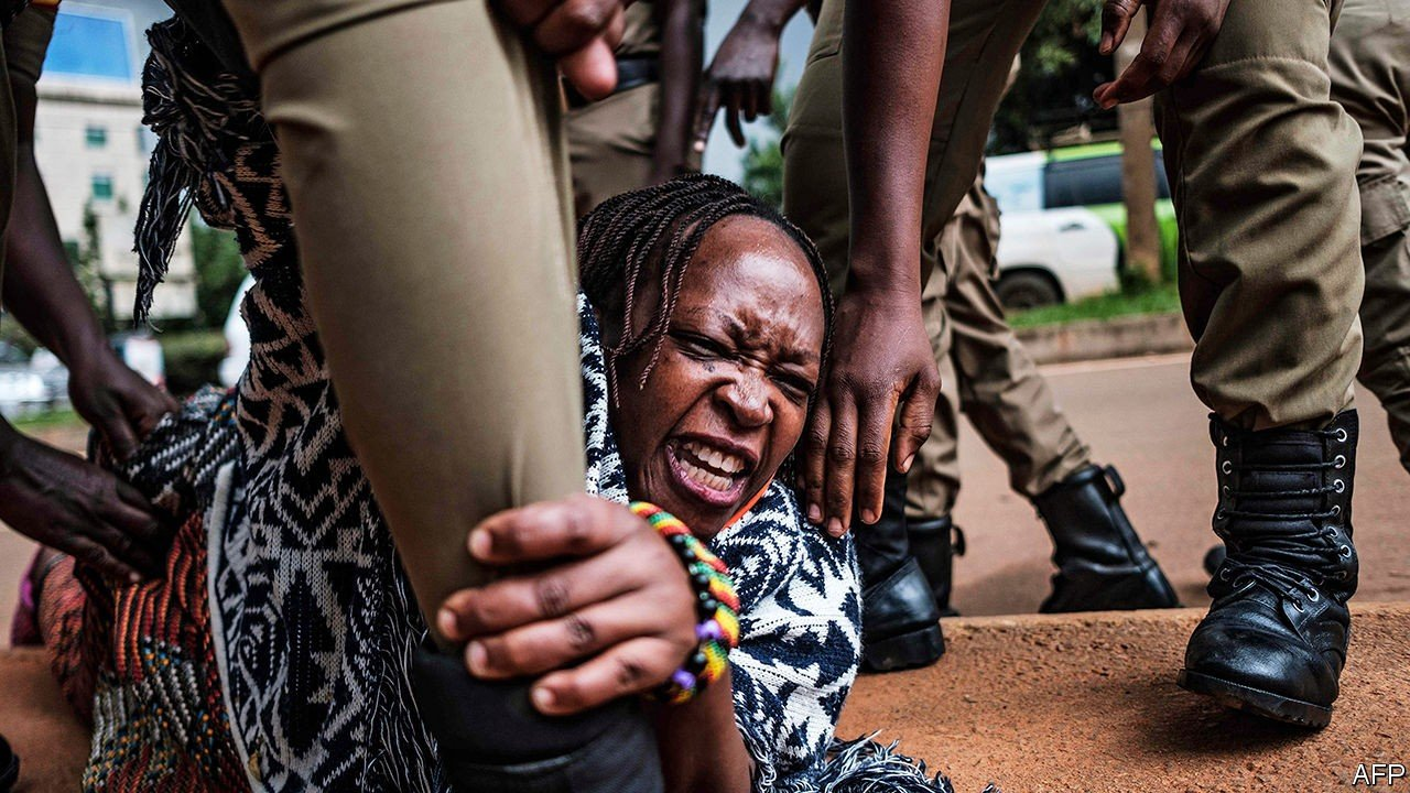 An African woman resists the police at anti-Museveni protests in Uganda