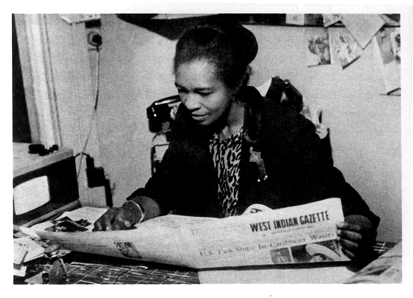 Caribbean intellectual Claudia Jones reading at a desk