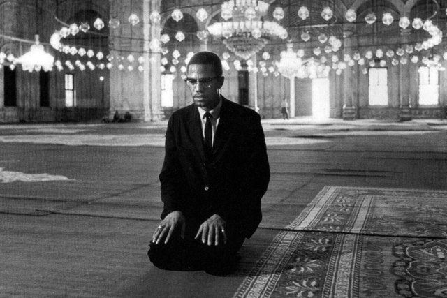 Activist Islam: Malcolm X praying at a mosque in Cairo while on his pilgrimage to Mecca in 1964.