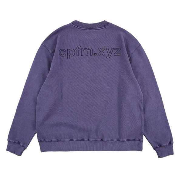 """The i like you you're different sweatshirt gives late 90's vibes with two yellow smilies and black text """"I like you you're different"""", reminiscent of Nirvana's Nevermind album cover."""