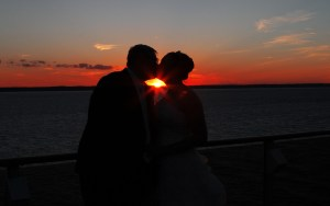 A wedding on the cruise, with a sunset in the background.