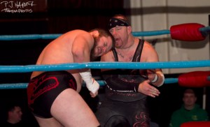 Rob Cook (IB Green) battles with Joe Gacy during the Xcite Wrestling championship match Jan. 4.