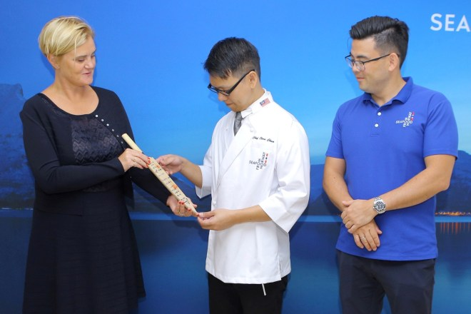Chef Chua is also presented with a knife by Norwegian Ambassdor Gunn Jorid Roset