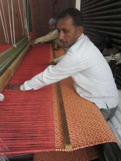 A pair of our skilled weavers hard at work.