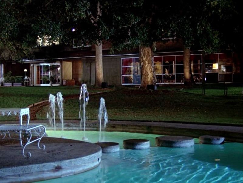 Hart to Hart TV show back of house with pool at night