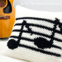 A thumbnail photo of the Music Notes Pillow Cover free crochet pattern