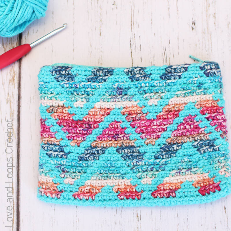 A photo of a colourful chevron crocheted pouch