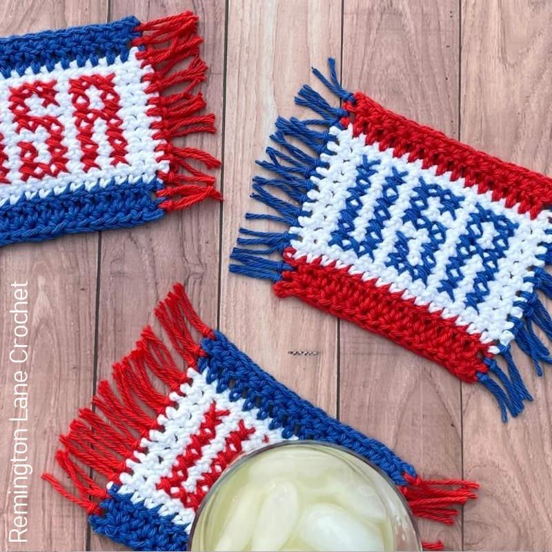 A photo of 3 USA crocheted mug rugs on a table