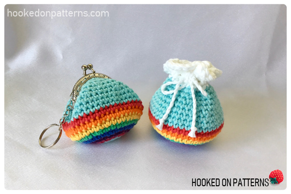 A photo showing the finished crochet rainbow purse in both the kiss lock clasp version, and the cloud topped drawstring version