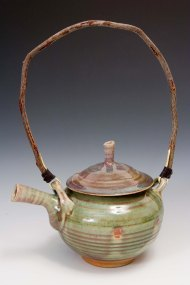 teapot with dogwood handle and oribe glaze. SOLD