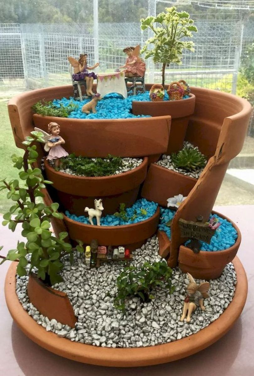 Lovely Beautiful Fairy Garden Design Ideas 28