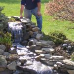 Make a mini waterfall in the garden 27