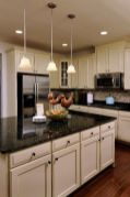 Elegant Kitchen Light Cabinets with Dark Countertops 56
