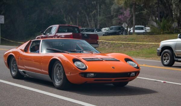 Valentino Balboni driving a Lamborghini Miura on Amelia Island