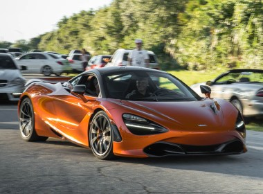 Orange McLaren 720S leaving duPont Registry