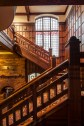 The impressive main staircase highlights Hooper's typical  wood panelling.