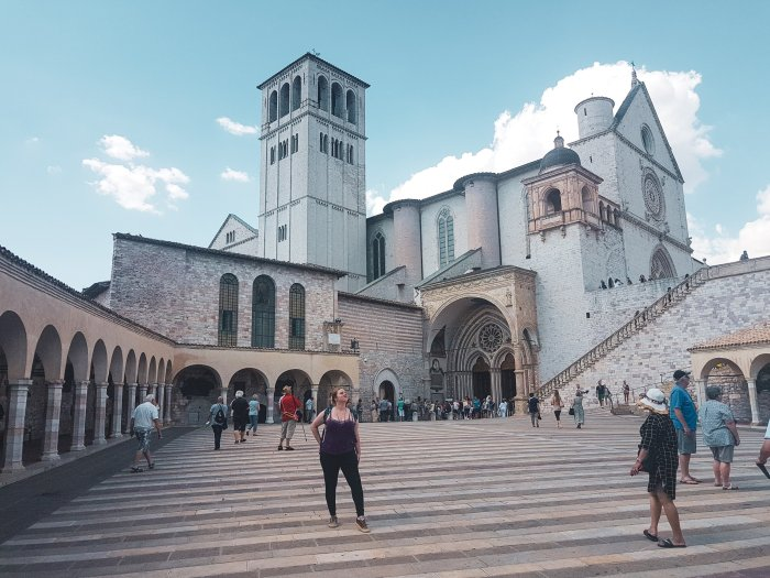 Jen standing outside of St Francis' Cathedral in Assisi-Alternative-Romantic-Destinations-Europe