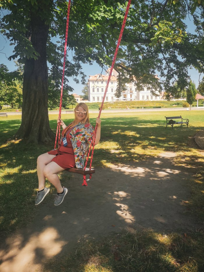 Jenni on a swing in a garden-Angloville-Honest-Review-Europe-Hoopla-Adventures