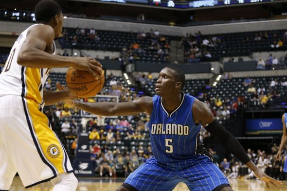 Oct 8, 2015; Indianapolis, IN, USA; Indiana Pacers guard Glenn Robinson III (40) holds the ball as Orlando Magic guard Victor Oladipo (5) defends at Bankers Life Fieldhouse. The Pacers won 97-92. Mandatory Credit: Brian Spurlock-USA TODAY Sports