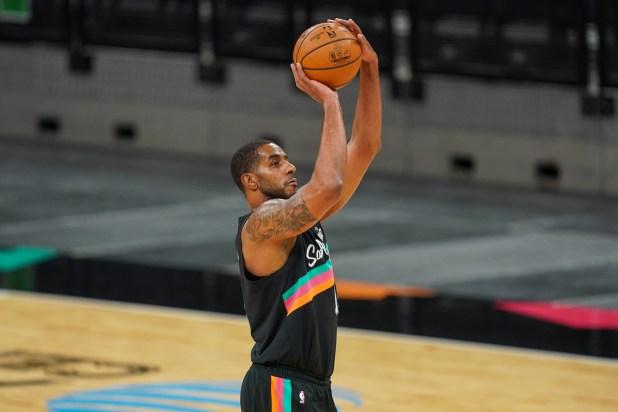 January 22, 2021;  San Antonio, Texas, United States;  San Antonio Spurs center LaMarcus Aldridge (12) shoots in the first half against the Dallas Mavericks at the AT&T Center.
