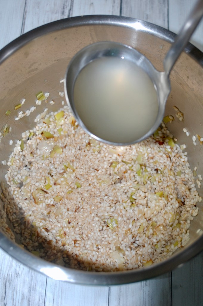broth being added to rice