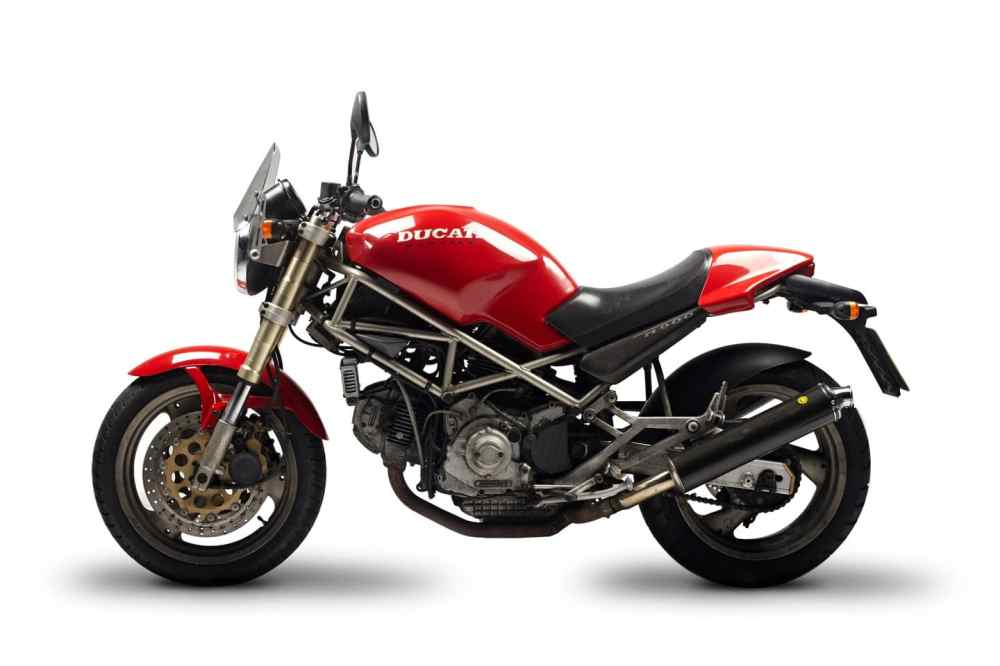 medium resolution of the original 1994 ducati monster with its gold frame a little obscured in this photo