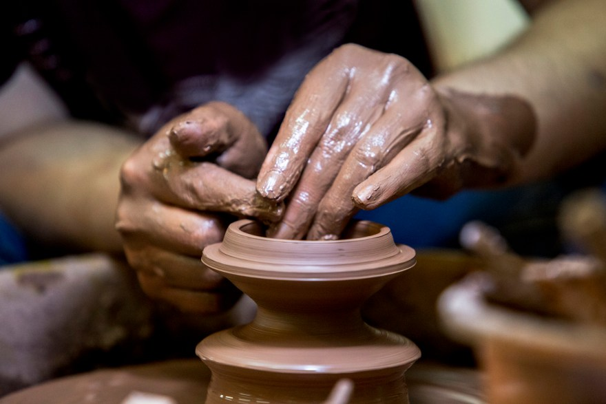 hand making pottery tea cup