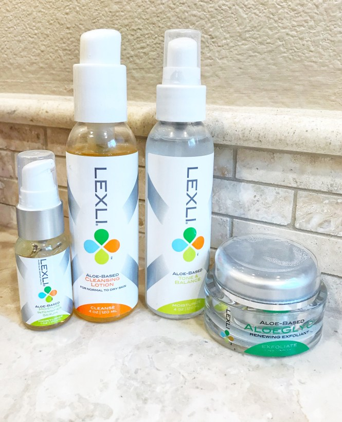 4 skincare products from Lexli skincare lined up on a granite countertop